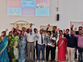 congregation waving