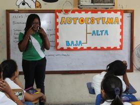 Damaris Guaza Sandoval of Colombia facilitates a workshop on self-esteem for a fourth-grade class at the Francisco Morazán school in La Ceiba, Honduras