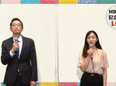 two young Asian people speak into microphones